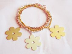 Solid Daisy Charm Bracelets - Rose Gold, Sterling Silver and Yellow Gold.