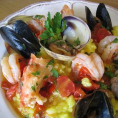 The best Italian Seafood Risotto Fruitti di Mare recipe, made with shrimp, mussels, clams, crab, white wine, garlic, tomatoes and saffron.