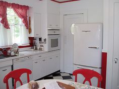 """Red and white kitchen  he """"topper"""" curtains, typical of the 1950s, I ordered online from Country Curtains – Gingham ruffled. And I picked up a few red accessories, but tried not to go overboard.    Read more: Sunny red and white vintage kitchen for David's 1930 Dutch colonial house — Retro Renovation"""