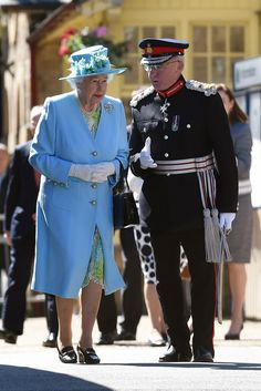 Queen Elizabeth II walks with Lord Lieutenant of Derbyshire, William Tucker following her arrival at Matlock Station on July 10, 2014