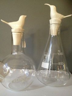 science decanters with bird stoppers