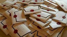 I love these wedding invitations! Black and white and red wax seal diy super elegant and classy but reminds me of Harry Potter too!
