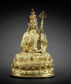 A gilt-bronze figure of Padmasambhava 16th century