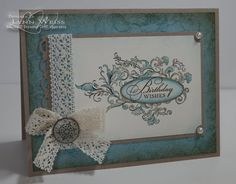 Elizabeth stamp. I used my Aquapainter and Baja Blue & Crumb Cake ink. The sentiment is from Watercolor Trio and stamped in Early Espresso.    The Baja Blue background panel was stamped with the large floral image from Elements of Style and then the edges were sponged with Early Espresso. I accessorized Elizabeth with some Chantilly Lace, Adhesive Pearls and one of the gorgeous Antique Brads.