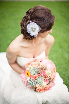 pastel bouquet with succulents and roses.  pretty for the bridesmaids.  I like that blue/green color a lot