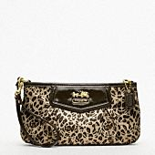 Madison Ocelot Op Art Large Wristlet by Coach. $98.00 (I can clearly see my name is spelled in the spots ;) )