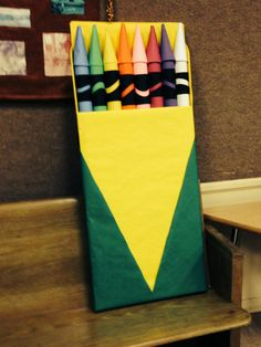 From VBS Leader...Crayon box -- about 4'x2'. Pool noodles (halved) covered with construction paper. See Decorating Guide for step-by-step instructions to create! www.cokesburyvbs.com