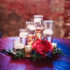A simple centerpiece can be very effective when paired with enough candles and a small floral arrangement.