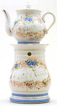 """Teapot #384  Cylindrical, white background with garlands of blue and white floral decorations, """"Bon Soir, Bonne Nuit"""", blue band around stand and bottom of pot.  Acquired in Tours"""