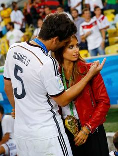 Germany's Mats Hummels speaks to his girlfriend Cathy Fischer.