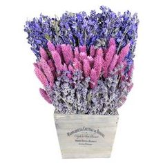 Preserved lavender and phalaris with larkspur in a tapered square planter.  Product: Preserved  floral arrangementConstruction Material: Silicone and natural twigsColor: Pink, purple and whiteDimensions: 12 H x 9 W x 5.5 D Cleaning and Care: Wipe gently with a dry cloth