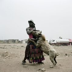 Nigerian with his pet hyena.  Found here: http://safe4work.org/a-nigerian-with-his-pet-hyen/
