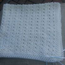 Handmade crocheted Christening/Baptism/Baby Shower/Newborn Gift baby blanket. I only use quality yarn which feels very soft to the touch.  Machine washable and dryer safe. Wonderful heirloom which can be passed from generation to generation for either a boy or girl. Comes from a smoke free home.