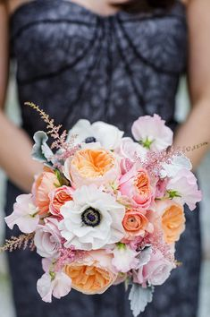 Dark accent in the anemones as a way to tie in the navy bridesmaid dresses?