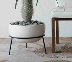 This planter stand, designed by John Follis, fits the FX vessel. Note: The vessel pictured above is not included and must be purchased separately. This item is