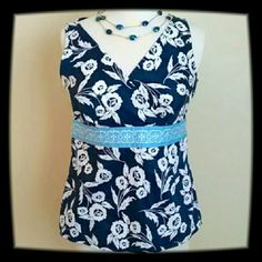 Ann Taylor Loft Top It's a navy and white flower pattern with a baby blue design under the bustline. It zips on the side. Ann Taylor Loft Tops