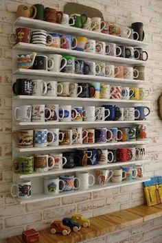 33 Signs That Coffee Owns You... Yup. I have a slight problem; but i really like that shelving idea for mugs.
