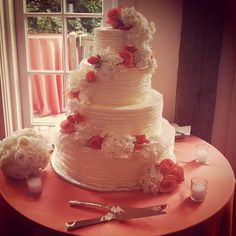 ruffled, coral, and gorgeous. love the four tiers! wedding cakes by tfc