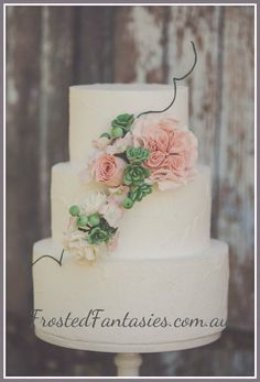 Really like the flower placement and the succlents that are used... Would like flowers to match color scheme and would like a few flowers on top with the cake topper....