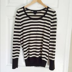 Dark brown and white striped Ann Taylor sweater Like new condition Ann Taylor scoop next sweater. Beautiful chocolate brown and off white striped ... Merino wool blend. Sweater is rather sheer. Ann Taylor Sweaters Crew & Scoop Necks