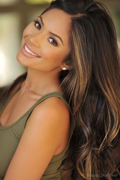 Dark brown hair with caramel-y highlights.