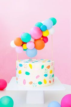 Make this DIY Balloon Cake Topper for your next party!  It's easy to make and adds amazing fun and color to any cake. Sugar & Cloth #party #cake #balloons