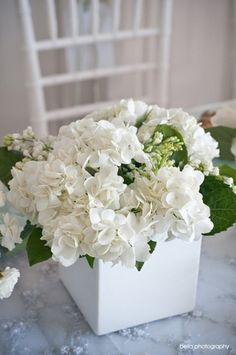 Erik likes hydrangeas as centerpieces, and I like how low this is - but I would prefer glass vases, candles, and definitely a few other flowers, whether white or yellow or something!