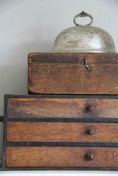 Boxes and silver cloche