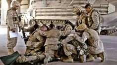 Marines praying over fellow Marine http://bit.ly/HqvJnA