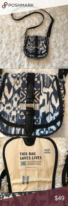 "TOMS Crossbody Bag Great condition TOMS cross body bag! This is a reposh so I'd like to make Back what I paid for it.  Geometric Aztec blue and cream color with adjustable strap. ""One for All"" stamp on the strap.  Has one interior zipper pocket, and closes shut with a magnet. Never used! There is a mark on the interior flap (photo) but that's just from it being closed for so long. TOMS Bags Crossbody Bags"
