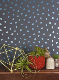 SISTERS OF THE SUN WALLPAPER in blue velvet (metallic blue) on charcoal, JUJU Papers, $200 per roll   Star Wars-inspired home decor, The Force Awakens home decor, modern home design, interior design
