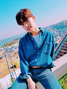 PLEDIS 17 - Dino with a gorgeous view of Seoul behind, I presume, on account of that bridge and river..  and it looks like a hot, sunny summer day.. This is my idea of heaven on Earth..