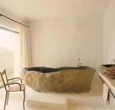 stone bath, dark interior [i've only ever bathed in white 'tubs, the dark here reminds me of swimming in the ocean - cool.]