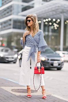 Flared white pants with a gingham wrap top and red heels