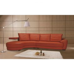Good-Looking Orange Leather Sofas You Must Have : Gorgeous Orange Leather Sofa with White Lampshade Metal Arc Lamp and White Shag Rug also Wooden Floor for Charming Living Room Design