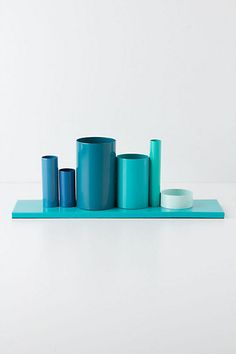 Multiples Pencil Holder - Anthropologie.com Recycle containers and use high gloss paint and sealer to get a similar finish.  Could also be cool covered in paper with great designs.