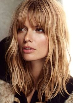 Medium Wavy Haircut with Blunt Bangs