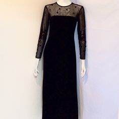 """J.R. Nites Caliendo Velvet Formal Long Dress J.R. Nites by Caliendo Velvet Formal Long Dress. Size 8. Sleeves are composed with sequins and black roses Note: A few sequins missing on sleeves. Armpit to Armpit 15.5"""", Waist 15"""", Length 54.5"""" Sleeves 22.5"""". Body: 90% Polyester, 10% Spandex. Sheer: 76% Nylon, 24% Spandex. Dry Clean Only. J.R. Nites by Caliendo Dresses"""