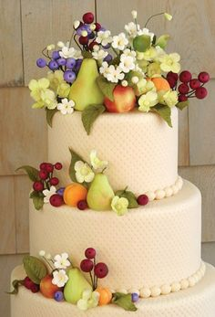The tiny fruits and flowers on this cake by Starlight Custom Cakes are perfection! See more cakes at: http://realmaineweddings.com/Planning-Tools/Maine-Cakes.aspx