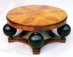 I love this art deco coffee table, but I am also weirded out by it. I'm not sure which would win if I put it in our living room.