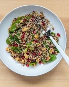 Ingredients: 2/3 cup cooked quinoa 1/2 cup pomegranate seeds 2 cups spinach, washed & dried 1 lemon 1/2 cup olive oil 1 clove garlic 1/4 cup toasted walnuts