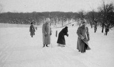 """Tsar Nicholas II of Russia running in the snow with his sister,Grand Duchess Olga Alexandrovna Romanova of Russia and officers are in the background. """"AL"""""""