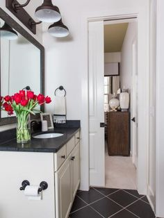 A pocket door opens the terrace suite bathroom to the adjoining bedroom. The goose neck double light over the vanity features an attractive oil-rubbed bronze finish.