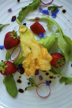 strawberry summer salad with the crunch of squash blossoms