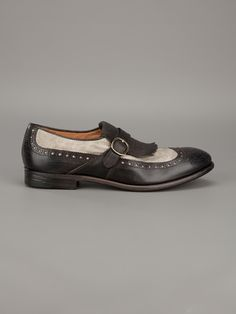 Two tone loafer from Henderson Fusion featuring a round toe, brogue detailing, front fringe with strap & silver-tone buckle, leather sole & heel