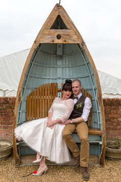 The bride & groom sit in the host on their wedding day at Jimmy's Farm, Suffolk. www.headoverheelsphotography.co.uk