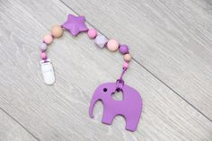 Silicone purple elephant teether with pacifier clip от TeetherLand