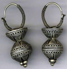 Afghanistan | Pair of Kazakh woman's earrings; silver. | Collection: Afghanistan Museum in Exile, Bubendorf, Switzerland. Accession No. 0594