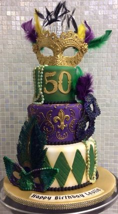 This cake relates to mardi gras because of the theme and the mask on top of it. I would like to have this at my mardi gras party because this is very festive and looks so good to eat. Mardi Gras Party Theme, Mardi Gras Food, Mardi Gras Decorations, Mardi Gras Beads, Moms 50th Birthday, Birthday Ideas For Her, 40th Birthday Cakes, 40th Birthday Parties, Birthday Wishes