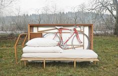 Travelbox: living essentials for a new apartment packed in one starter box by JUUST. Contains a bed, table, chair, bike, and storage.